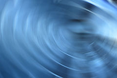 Abstract blue spinning lights line background Royalty Free Stock Photography