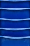 Abstract: Blue Stacked Chairs. Abstract closeup of blue stacked chairs with horizontal lines Royalty Free Stock Images