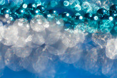 Abstract blue twinkled lights, background with bokeh defocused royalty free stock photos