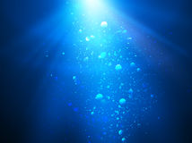 Abstract blue water background with sunbeams, backgrounds for your design Stock Photo