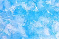 Abstract blue watercolor on white background.The color splashing in the paper.It is a hand drawn stock image