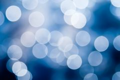 Abstract blue and white circular bokeh background. Of Christmas light Stock Photos