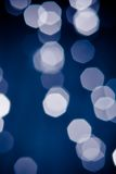 Abstract blue and white circular bokeh background Royalty Free Stock Photos
