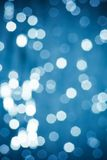Abstract blue and white circular bokeh background. Of Christmaslight Stock Photography