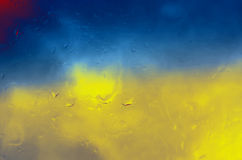 Abstract blue and yellow background. With water drops Royalty Free Stock Photo