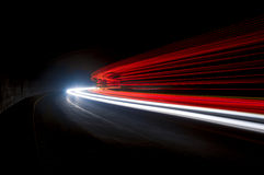 Abstract blue, yellow,red and white rays of light. In a car tunnel stock images
