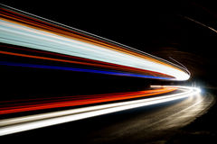 Abstract blue, yellow,red and white rays of light. In a car tunnel Royalty Free Illustration