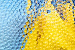 Abstract blue and yellow textured glass background Stock Photography