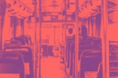Abstract blur background, Inside of public bus with seat and people in duo tone color style.  stock photography