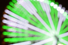 Abstract blur background of large Ferris wheel green lights Royalty Free Stock Photo