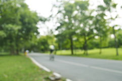 Abstract blur bicycle rider in park Stock Photography