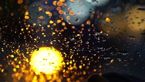 Abstract blur blinking traffic lighting in the rain stock video footage