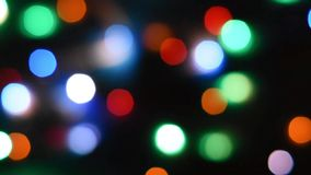 Abstract blur bokeh background. Colorful defocused bokeh background. Soft color blur on a black background. Beautiful colored boke. H lights. Christmas magic stock footage