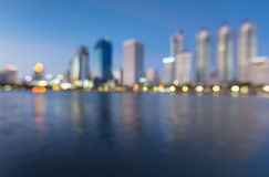 Abstract blur bokeh from business building at waterfront in Bangkok Stock Images