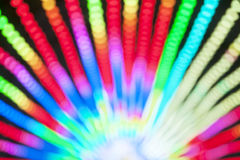 Abstract blur bokeh of colorful lights inside amusement park tunnel at night Stock Photos