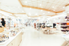 Abstract blur and bokeh defocused shopping mall interior of depa. Rtment store for background Stock Photo