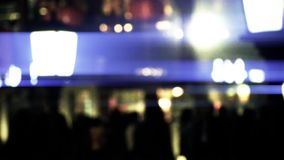 Abstract blur busy crowd silhouette on business street at night. Gh2_05046 stock footage