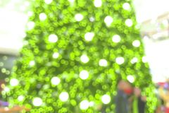 Abstract blur of Christmas tree in shopping mall for background.  Royalty Free Stock Images