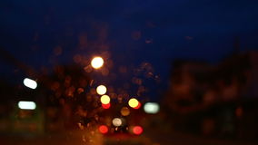 Abstract blur colorful light traffic on road with car driving in the rainy day defocused background stock video footage