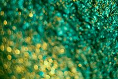 Abstract blur with a green crumpled foil texture for background. Artistic colorful bokeh. stock image