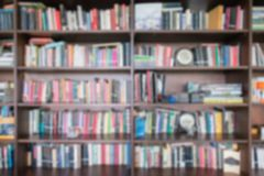 Abstract blur and defocused bookshelf in library interior for background.vintage bookshelf with many books for education in. Library royalty free stock images