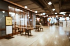 Abstract blur and defocused in luxury shopping mall and retail s. Tore for background - vintage effect filter royalty free stock photography
