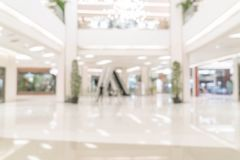 Abstract blur and defocused luxury shopping mall and retail stor. E for background royalty free stock photography