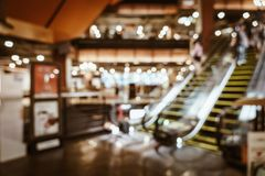 Abstract blur and defocused in luxury shopping mall and retail store for background. Vintage effect filter royalty free stock photos