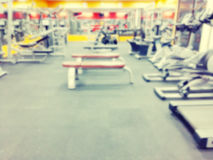 Abstract blur fitness gym room interior background - Vintage fil Royalty Free Stock Photo