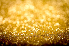 Abstract blur golden bokeh lighting from glitter texture Royalty Free Stock Image