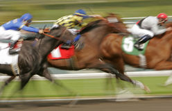 Abstract Blur Horse Race. Slow shutter speed rendering of racing jockeys and horses royalty free stock photos