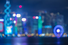 Abstract blur image of Hongkong city with circle bokeh. Blurred city lights bokeh cityscape with water river reflexion Royalty Free Stock Photo