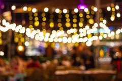 Abstract blur image Lots of people enjoy the fun of night festival in a restaurant. And The atmosphere is happy and relaxing stock image