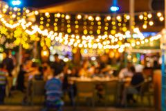 Abstract blur image Lots of people enjoy the fun of night festival in a restaurant. And The atmosphere is happy and relaxing stock photo