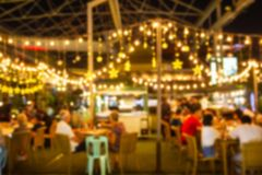 Abstract blur image Lots of people enjoy the fun of night festival in a restaurant. And The atmosphere is happy and relaxing royalty free stock photography
