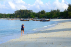 Abstract blur jogging woman. Female runner jogging barefoot in m. Oring on beach; Lipe Island, Thailand Royalty Free Stock Photos