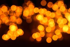 Abstract blur orange sparkle bokeh background. Blurred defocused lights in orange colors. Blurred Bokeh. Christmas light stock images