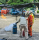 Abstract blur people practicing how to stop fire in fire fighting training course. Safety first. Royalty Free Stock Images