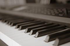 Abstract blur of Piano Keyboard synthesizer closeup key frontal Royalty Free Stock Photos