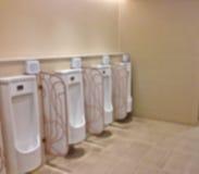Abstract blur row of urinals men public toilet Stock Photos