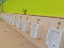 Abstract blur row of urinals men public toilet Stock Photography