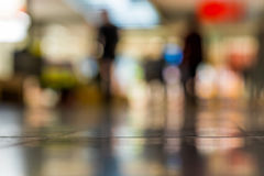 Abstract blur shopping mall background with people. Empty floor. For copy space and bokeh Royalty Free Stock Photography