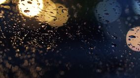 Abstract blur traffic lighting in the rain Stock Image