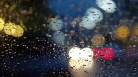 Abstract blur traffic lighting in the rain Royalty Free Stock Photo