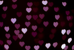 Abstract - blur violet heart lights - love sign stock photography