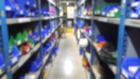 Abstract blur walking in Machinery parts and Engine spare parts store stock footage
