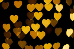 Abstract - blur yellow heart lights - love sign royalty free stock images