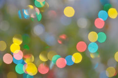 Abstract blurred background of colored lights of Christmas garland royalty free stock image