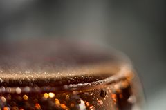 Abstract blurred background with a drink in a glass with a bokeh macro Stock Photos