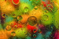Abstract blurred background with glass and ointment.
